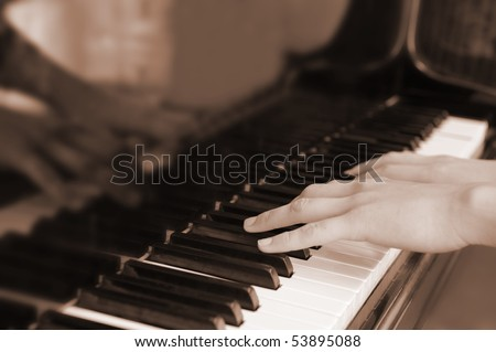 Hands above keys of the piano. A photo close up.Old color - stock photo