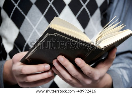 Hands and Bible - stock photo