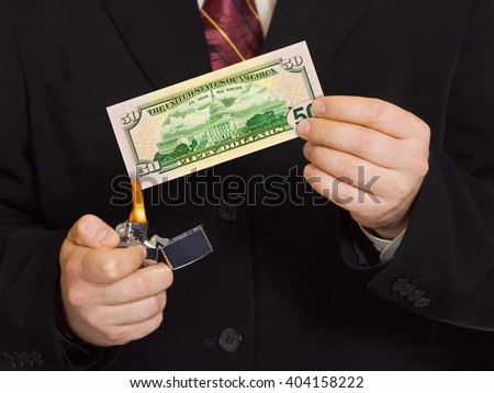 Hands and burnning money - business concept - stock photo