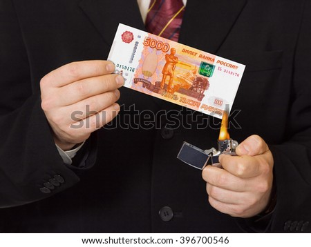 Hands and burnning russian money - business concept