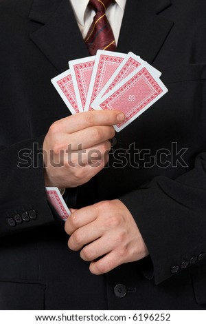 Hands and card in sleeve, poker game - stock photo