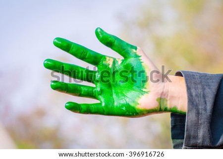 Hands and fingers stained with Food coloring.(green) - stock photo