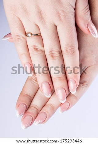 Hands and nails isolated on white background