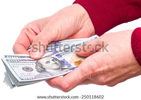 Hands and new hundred dollar bills  isolated on white background - stock photo