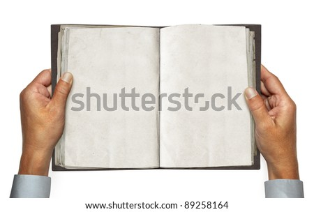 hands and opened vintage book over white background with path - stock photo