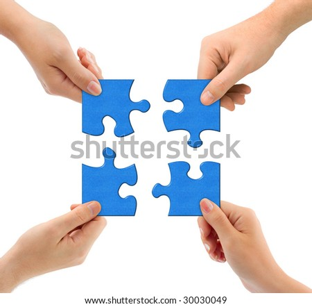 Hands and puzzle isolated on white background - stock photo