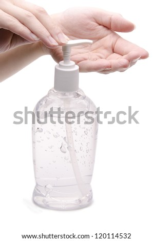 Hands and sanitizer dispenser - stock photo