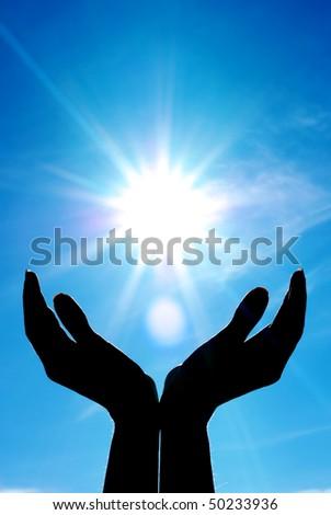 Hands and sun. Conceptual design. - stock photo