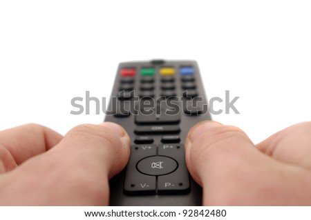 hands and tv remote control - stock photo