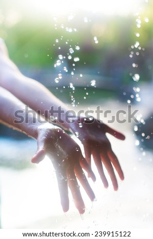 Hands and water - stock photo
