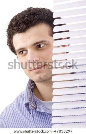 hands apart on the window blinds - stock photo