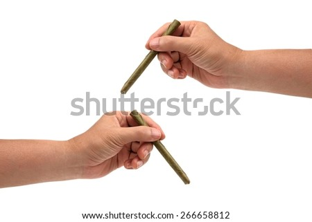 Hands are holding a cigarette