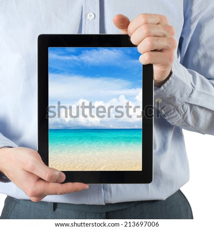 hands are holding the tablet computer - stock photo
