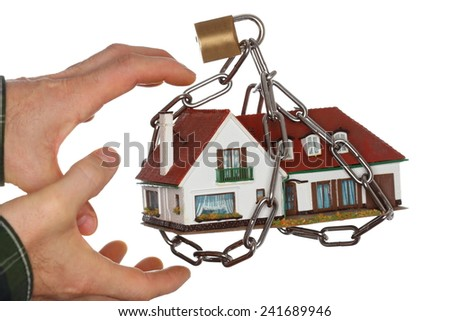 hands are taking a chain protected house model