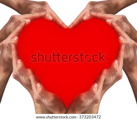 Hands arranged around a red heart shape. Love concept - stock photo