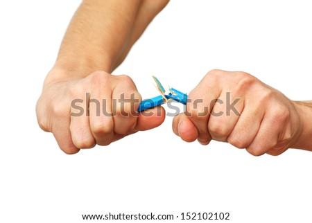 Hands breaking pencil - stock photo