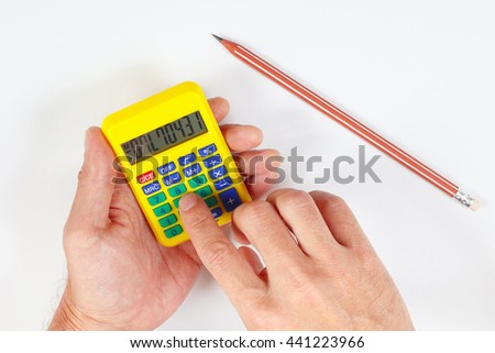 Hands calculate using a pocket digital calculator on a white background - stock photo