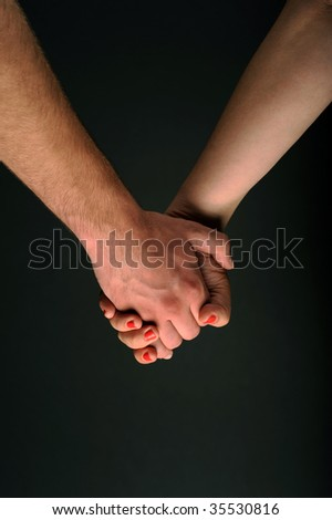 Hands caring and supporting each other - stock photo