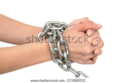 Hands chained isolated on white background - stock photo