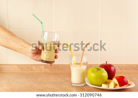 Hands chef offers a fruity cocktail in glasses - stock photo