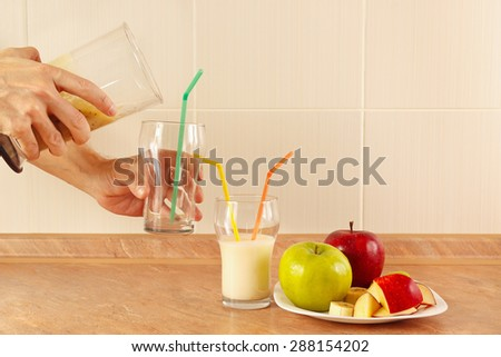 Hands chefs poured fruit smoothie in the glasses - stock photo