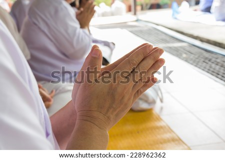 hands clasped in a prayer - stock photo