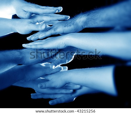 hands clasped showing determination - stock photo