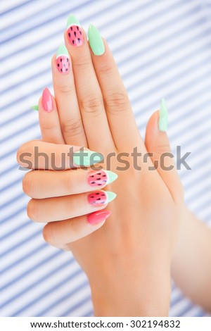 Hands close up of young woman with watermelon manicure summer  nail art  concept  - stock photo