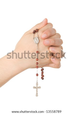 Hands closed in prayer with a rosary isolated on white background - stock photo