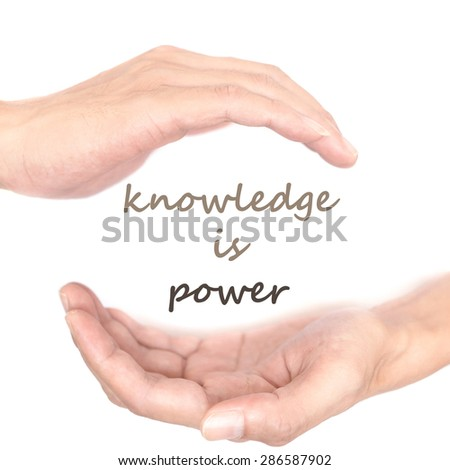 Hands concept for knowledge is power. Quote is between right and left hand - stock photo