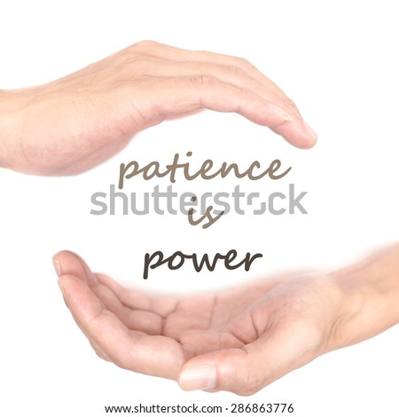Hands concept for patience is power. Quote is between right and left hand - stock photo