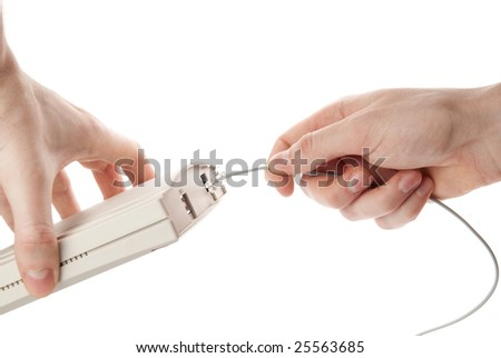 hands connecting network cable to  router. - stock photo