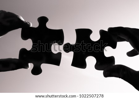 hands connecting two puzzle pieces ideas stock photo edit now