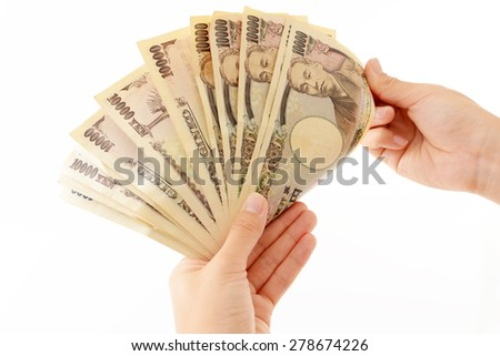 Hands counting money isolated on white background - stock photo