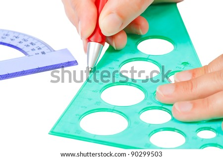 Hands draw with a pencil, ruler and protractor - stock photo