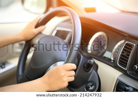 hands driving a car  - stock photo