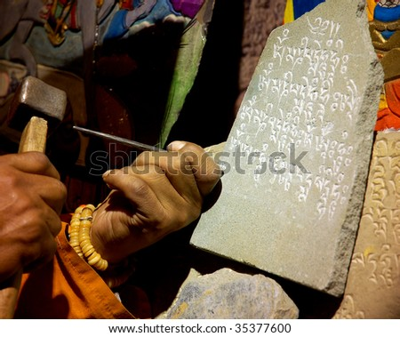 hands engraving stone - stock photo