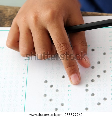 hands examination answer sheet - stock photo