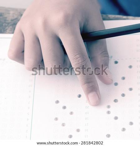 hands examination answer sheet vintage version - stock photo
