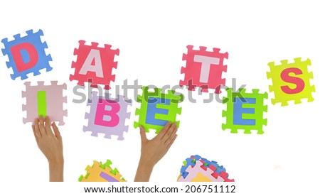 "Hands forming word ""Diabetes"" with jigsaw puzzle pieces isolated - stock photo"