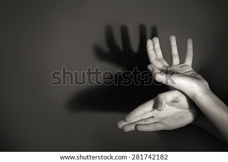 Hands gesture like deer on gray background - stock photo
