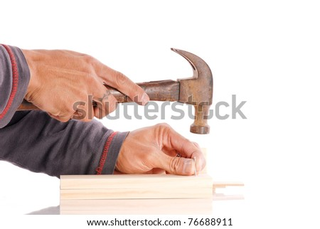 Hands Getting Ready to Hammer in a Nail