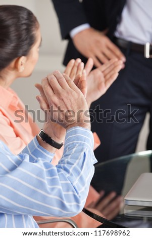 Hands giving applause after a business presentation - stock photo
