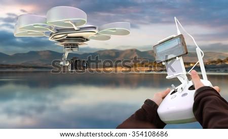 Hands guiding a drone through a remote control - stock photo