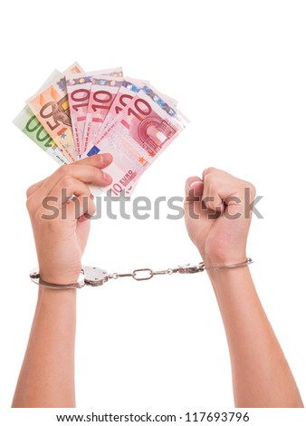 Hands, handcuffs and Euro notes - conceptual shot around counterfeit money - stock photo