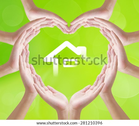 Hands heart shape on home background , concept design - stock photo