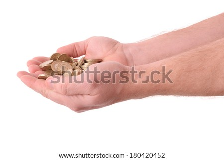 hands held out holding gold coins isolated on a white background - stock photo
