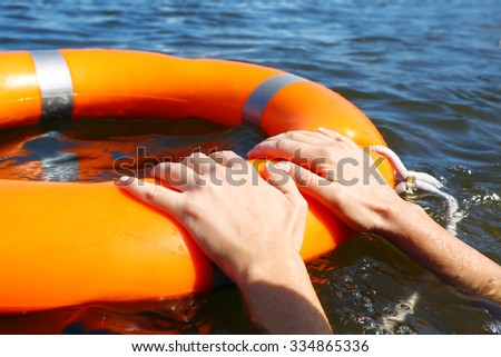 Hands hold a life buoy - stock photo