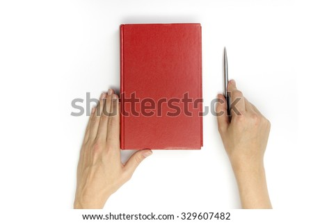 Hands hold blank red hardcover book and pen on white background. - stock photo