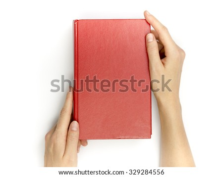 Hands hold blank red hardcover book on white background. - stock photo